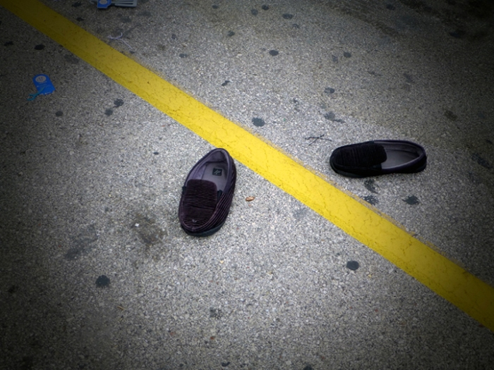 Discarded shoes in the Walmart parking lot.