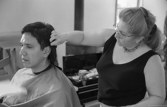 Actor Michael Greyeyes receiving hair extensions for a flash back scene.